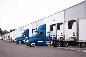 Trucks delivering to a retail distribution center